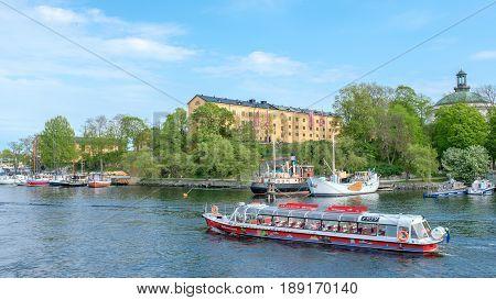 STOCKHOLM, SWEDEN - MAY 21, 2017: View from Skeppsholmen bridge towards Skeppsholmen island in Stockholm. The capital city of Sweden is built on 17 islands.
