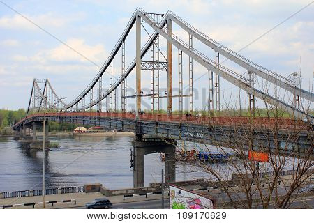 KIEV, UKRAINE - MAY 1, 2011: Park Bridge is a pedestrian cable-stayed bridge across the Dnieper to the recreation area.