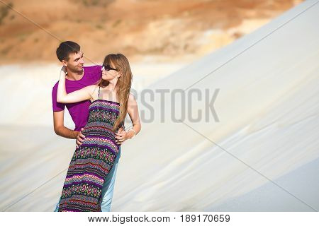 tender lovers on romantic travel honeymoon vacation summer holidays romance. Young happy couple on the beach with white sand, caucasian woman and man embracing and looking in each other