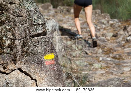 Tourist signs on the trail in mountains, Tourist signage with a running woman, Pedestrian signs