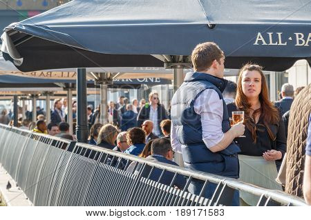 A Young Businesswoman With Her Colleagues At A Dockside Bar In Canary Wharf