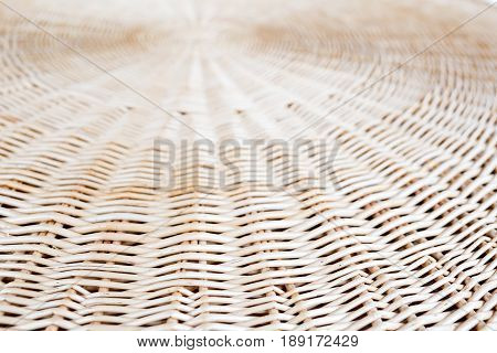 Cane or wickerwork background- showing the details of interlaced weave structure of basket or furniture.