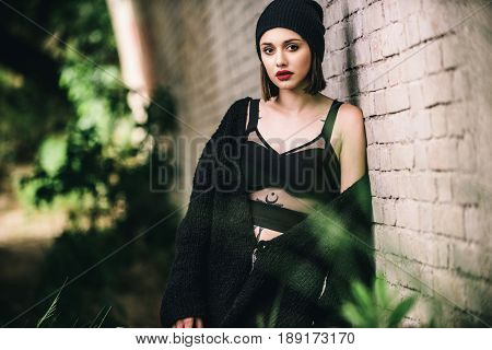 Beautiful fashion model with urban style posing outdoors