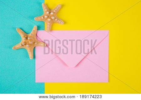 Pink Envelope With Two Starfishes On Colored Backgrounds With Negative Space