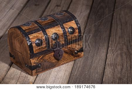 Wood treasure chest on a wooden surface