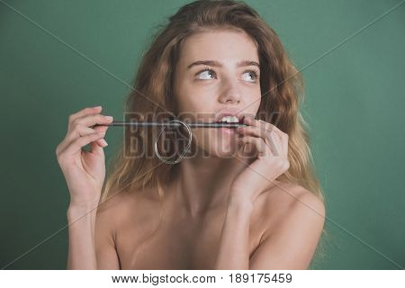 Girl Biting Metallized Nail With Healthy White Teeth