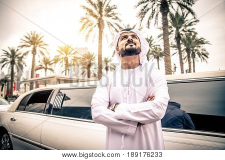 Arabic businessman in Dubai - Emirates man with limousine car