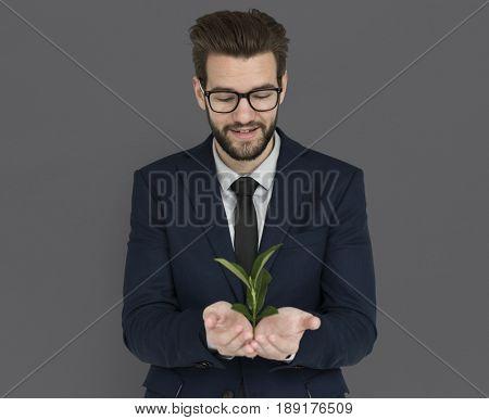 Caucasian Business Man Holding Seedling