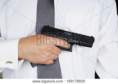 The businessman with the gun as allegory of rigid competitiveness