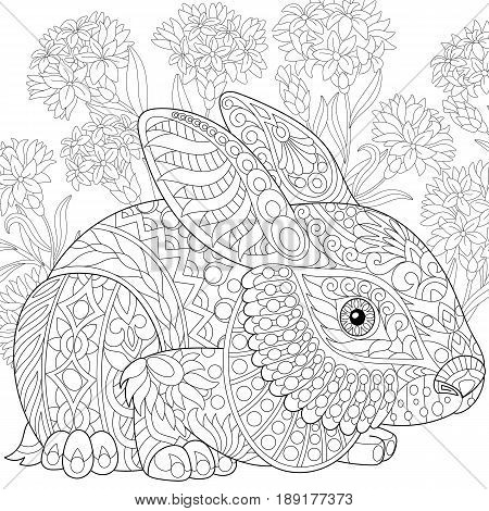 Stylized rabbit (bunny hare) and cornflowers. Freehand sketch for adult anti stress coloring book page with doodle and zentangle elements.