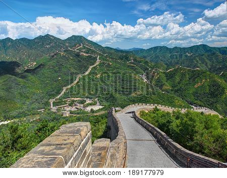 Perspective view on famous beautiful ancient Great Wall of China monument made of bricks stones. Old China architecture. China holidays vacation tours trips travel tourism. Famous sightseeing point