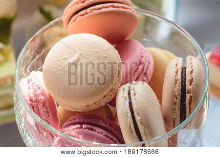 A french sweet delicacy macaroons variety closeup.macaroon colourful texture.