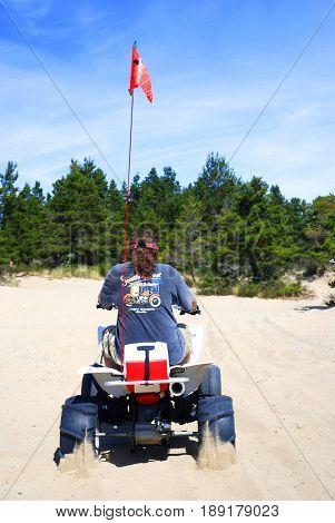 COOS BAY, OREGON, USA - September 3, 2009: Man riding his four wheel ATV at the Oregon Dunes National Recreation Area