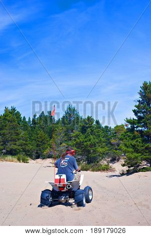 COOS BAY, OREGON, USA - September 3, 2009: Man rides his four wheel ATV at the Oregon Dunes National Recreation Area