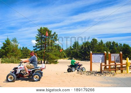 COOS BAY, OREGON - September 3, 2009: Two men four wheeling at the Oregon Dunes National Recreation Area