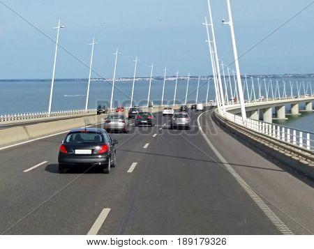 Traffic on the Vasco da Gama Bridge in Lisbon Portugal