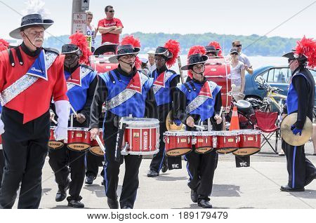 Bristol Rhode Island USA - July 4 2011: Line of marching band drummers at Independence Day parade in Bristol Rhode Island