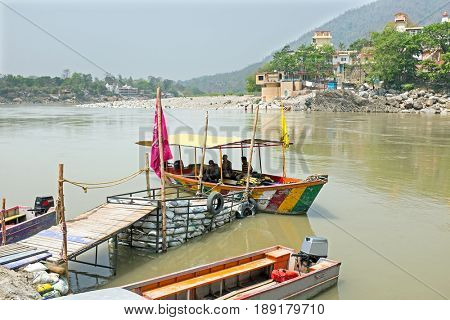Ferry on the river Ganga at Laxman Jhula in India Asia