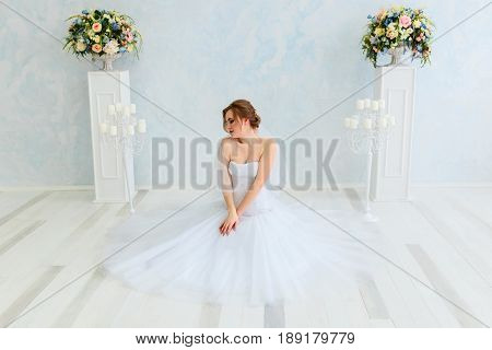 A bride in a beautiful dress. Wedding. Bride's morning. Happy Bride waiting groom.