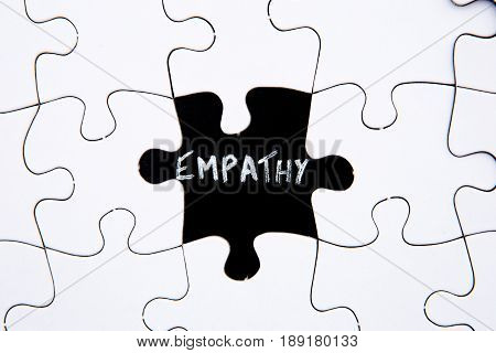 Puzzle Pieces - with word Empathy in black chalkboard space