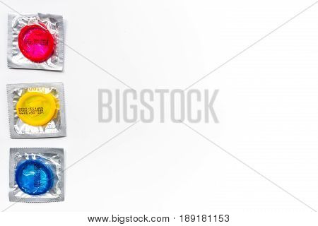 Condoms in package for safe sex on white background top view mock-up
