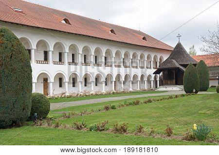 arched colonade of Sambata de Sus monastery in Transylvania Romania