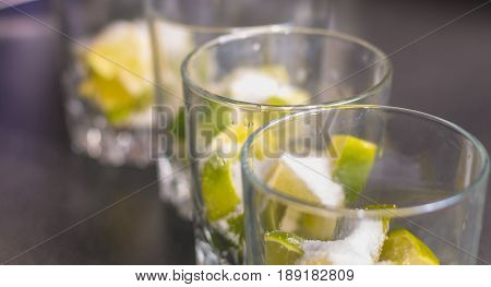 Lime Cut In Glasses With Sugar To Make Caipirinhas