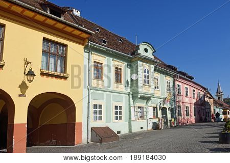 houses at Citadel Square in Historic Centre of Sighisoara Transylvania region in Romania