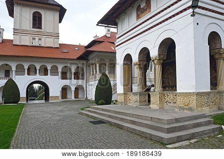 arched colonade and building of Sambata de Sus monastery in Transylvania Romania