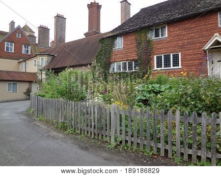Old English buildings and a beautiful fenced yard in West Essex, England. United Kingdom.