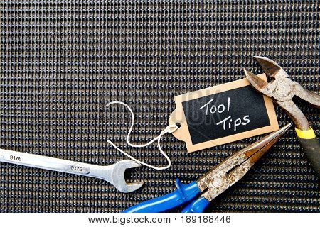 background - selection of tools on black mat background with Tool Tips tag