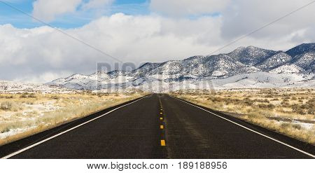 Long set of snowcovered foothills and ridges along highway 50 in Nevada