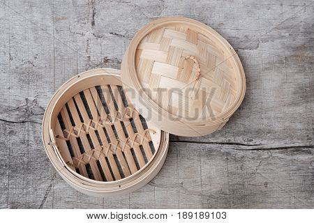 Isolated Empty Round Steamer Bamboo Basket Or Crate