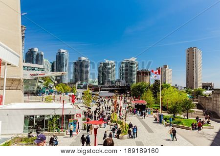 Toronto, Ontario, Canada, down town, May 20, 2017, amazing view of many people walking relaxing and having fun in Toronto down town area on sunny day