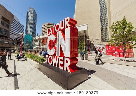 Toronto, Ontario, Canada, down town, May 20, 2017, nice amazing view of many people walking, sitting, relaxing and enjoying their weekend time on sunny day near cn tower