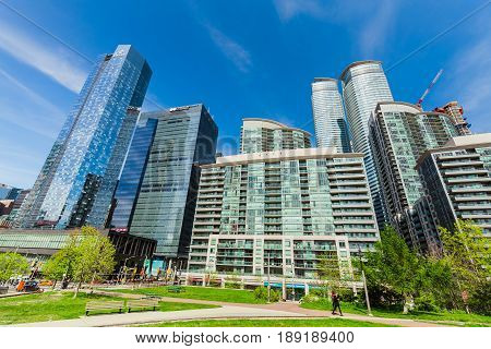 Toronto, Ontario, Canada, down town, May 20, 2017, amazing gorgeous view of various condo and office stylish modern buildings against blue sky background on sunny day