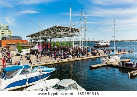 Toronto, Ontario, Canada, down town, May 20, 2017, great beautiful view of harbourfront area with many people gathered near the concert stage and watching live performance, lake Ontario