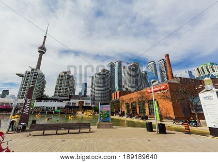 Toronto, Ontario, Canada, down town, May 20, 2017, amazing gorgeous view of various condo and office stylish modern buildings with cn tower behind, against blue sky background on sunny day