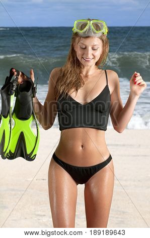 Snorkeling At The Beach. Woman With Diving Mask And Flippers