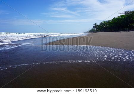 An Empty sandy shoreline in Costa Rica