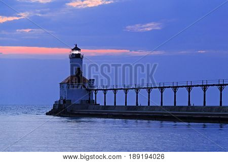 Sundown at the East Pierhead LIght at Michigan City Indiana on Lake Michigan