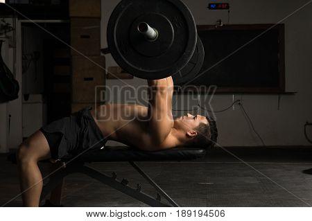 Shirtless Man In A Bench Press