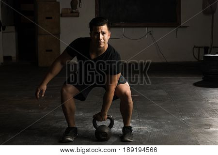 Sportsman Doing A Kettlebell Swing