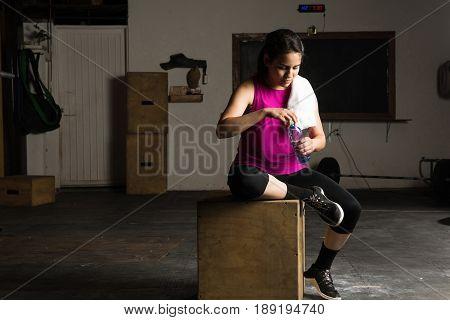 Cute Girl Taking Break In A Gym