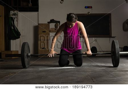 Woman Adjusting Her Grip On A Barbell