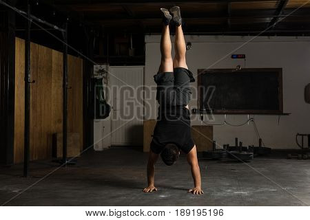 Strong Man Doing A Handstand At The Gym