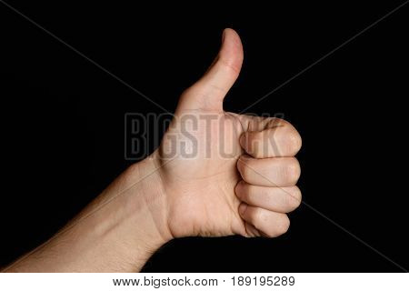 Showing A Thumb Up Gesture. Isolated On Black Background. Like.