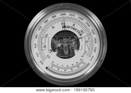 Old round barometer meter isolated over black background