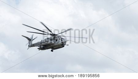CH-53 Super Stallion helicopter in flight. Markings have been removed