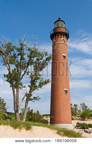 The lighthouse at Michigan's Little Sable Point rises from sand dunes overlooking Lake Michigan.